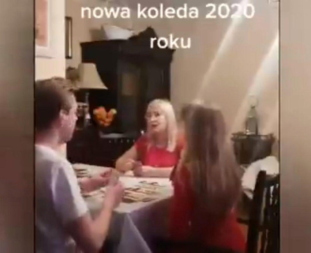 propolski.pl: Kobieta śpiewa z dziećmi nową kolędę